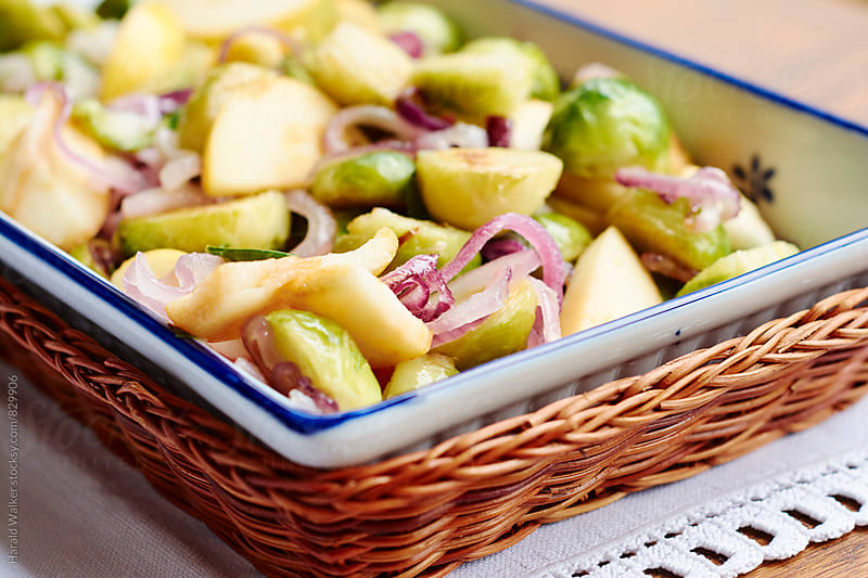 Brussels Sprouts with Apples and Red Onions by Harald Walker for Stocksy United
