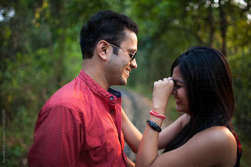 Young couple romancing in the forest by Apratim Saha for Stocksy United