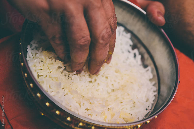 Hand picking rice from a bowl by kkgas for Stocksy United