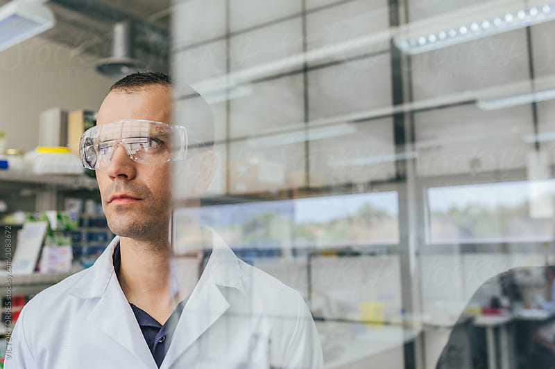 Portrait of a Young Researcher in a Professional Laboratory by Victor Torres for Stocksy United