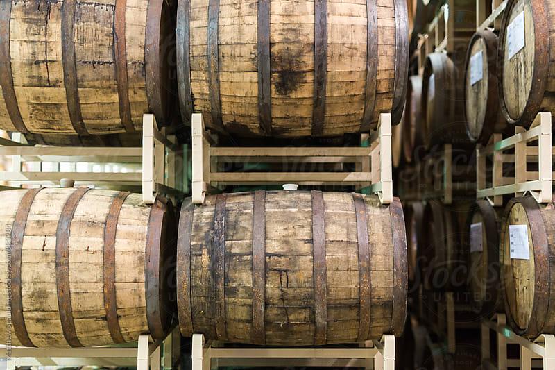 Wine barrels in storage for aging at vineyard by Matthew Spaulding for Stocksy United