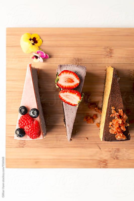 raw vegan dessert, cheesecakes slices by Gillian Vann for Stocksy United