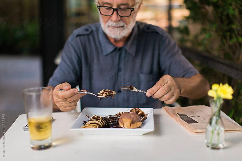 Senior Man Eating Dessert by Mosuno for Stocksy United