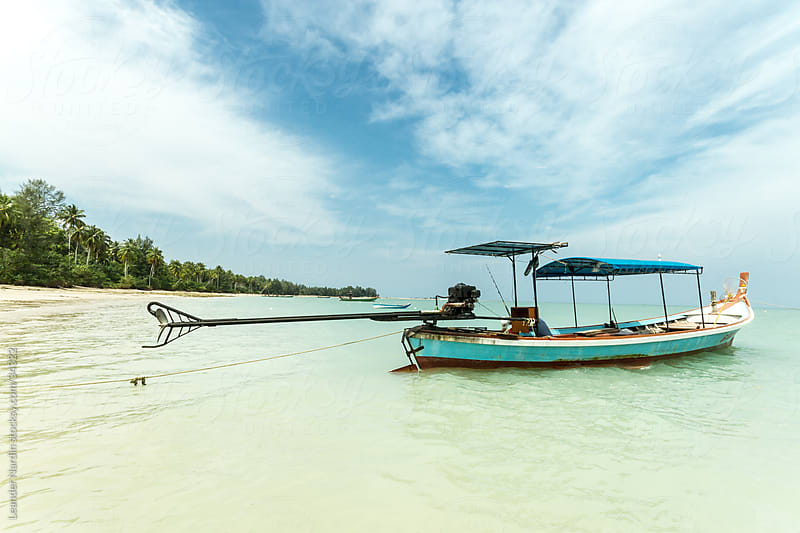 longtail boat in thailand by Leander Nardin for Stocksy United