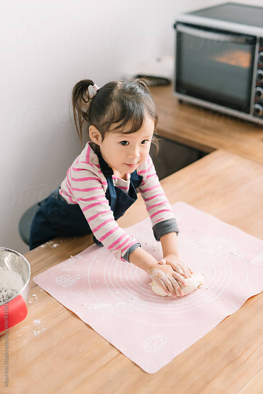 Toddler girl making dough by Maa Hoo for Stocksy United