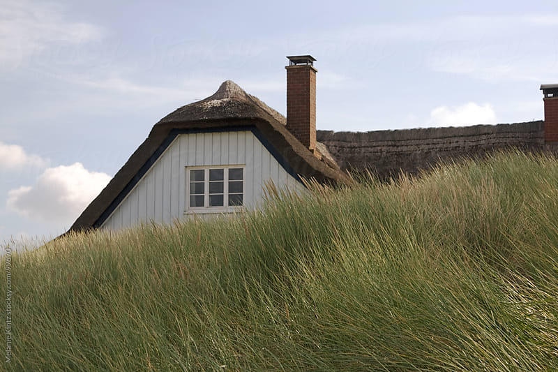 House hidden behind the dunes by Melanie Kintz for Stocksy United