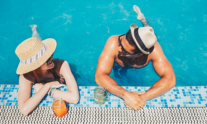 Couple Enjoying at the Swimming Pool by Lumina for Stocksy United