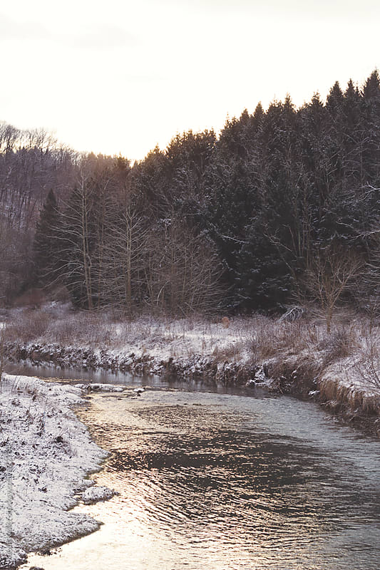 Snowy landscape with River During Sunrise by Kevin Keller for Stocksy United