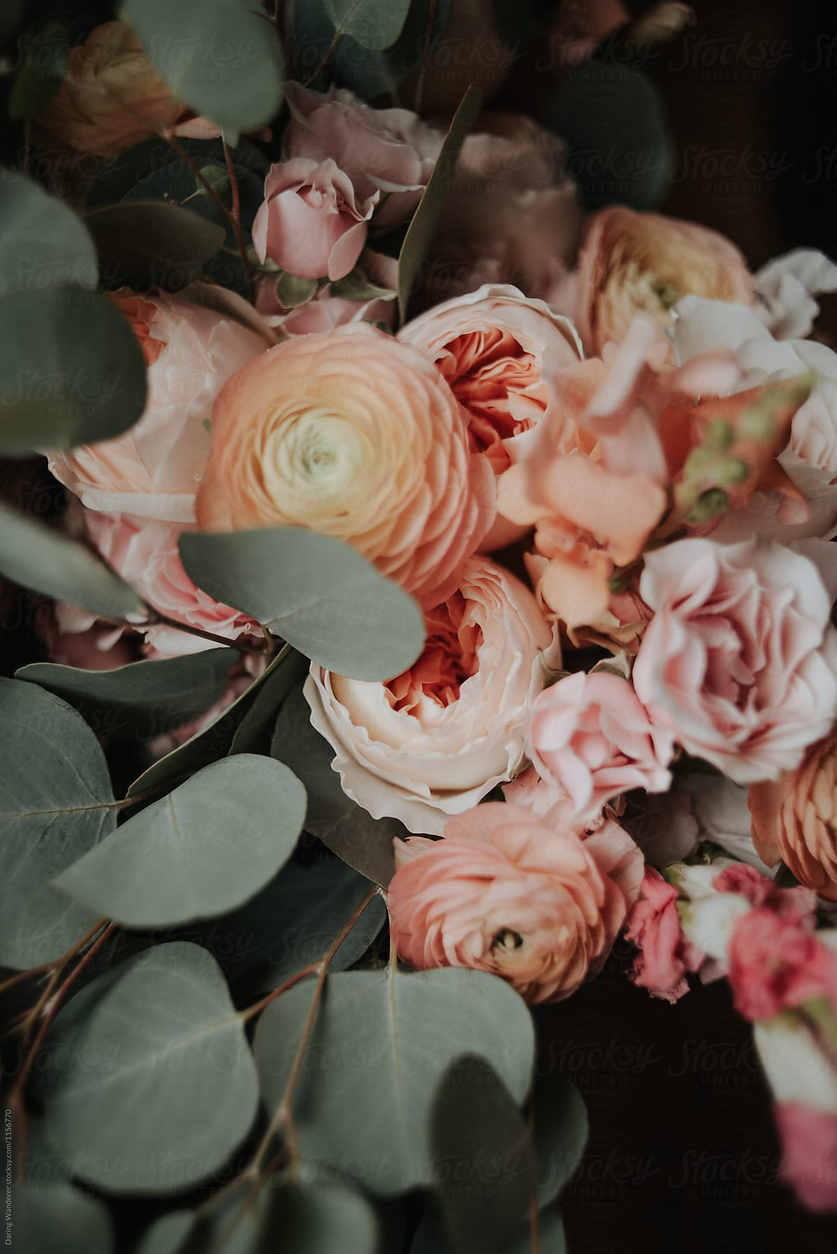 Pink And Coral Garden Rose Ranunculus And Eucalyptus Bouquet By Jess Craven Stocksy United
