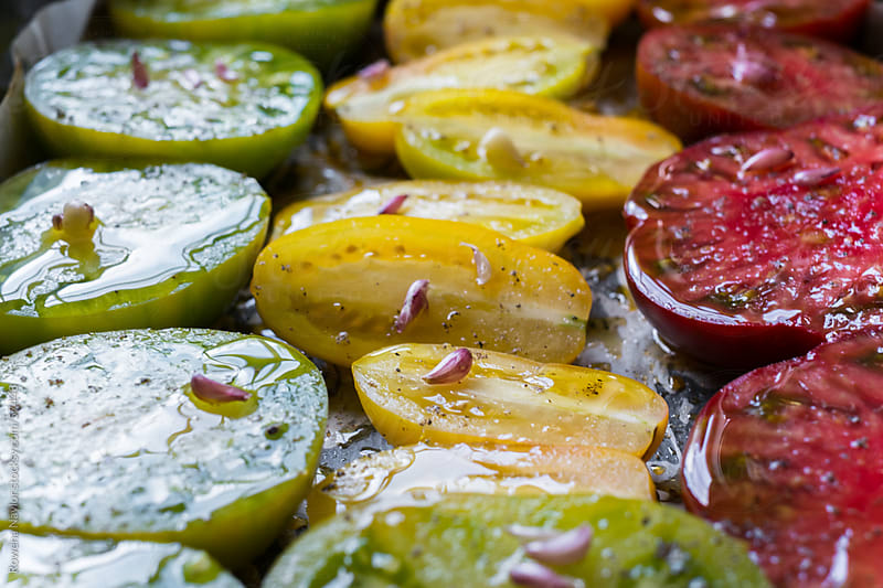 Roasting Heirloom Tomatoes by Rowena Naylor for Stocksy United