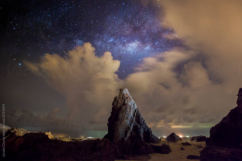 Beautiful night landscape with rocks and starry sky by Jacobs Chong for Stocksy United