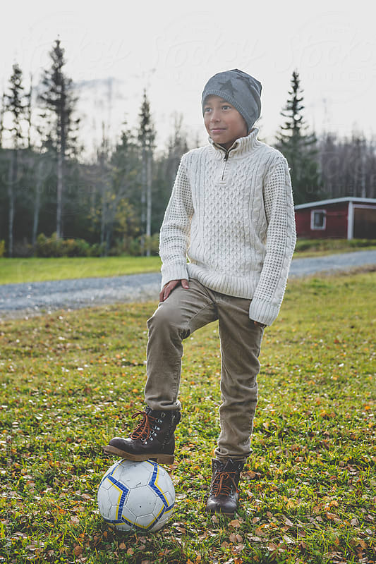 soccer kid in autumn  by Andreas Gradin for Stocksy United