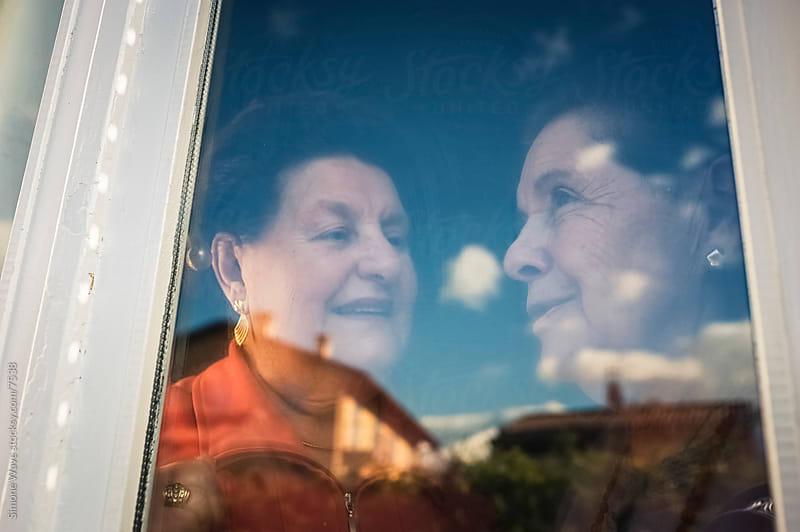 Seniors women at window by GIC for Stocksy United