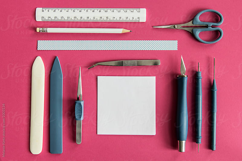 Papercraft tools on pink background by Melanie Kintz for Stocksy United