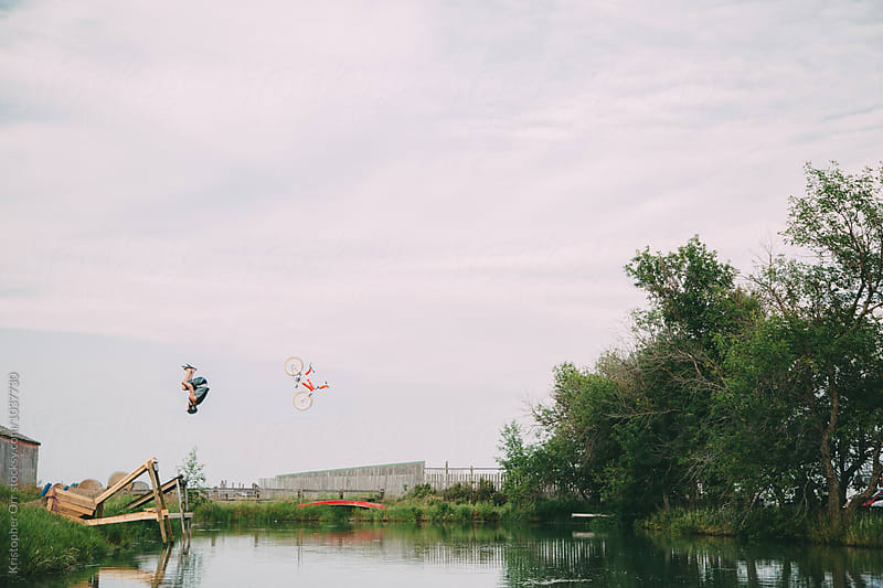 Young Male Backflipping into Pond by Kristopher Orr for Stocksy United