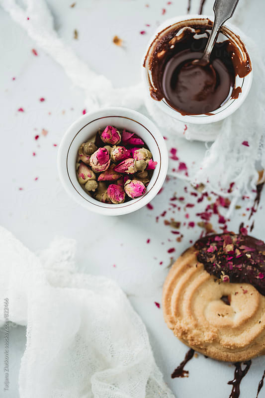 Cookies with chocolate and rose buds by Tatjana Ristanic for Stocksy United