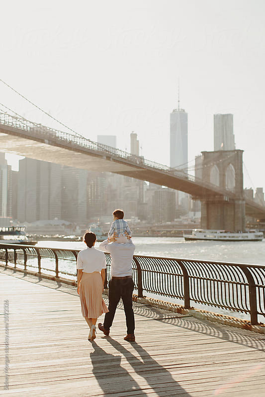 Young Family by Brooklyn Bridge by Sidney Morgan for Stocksy United