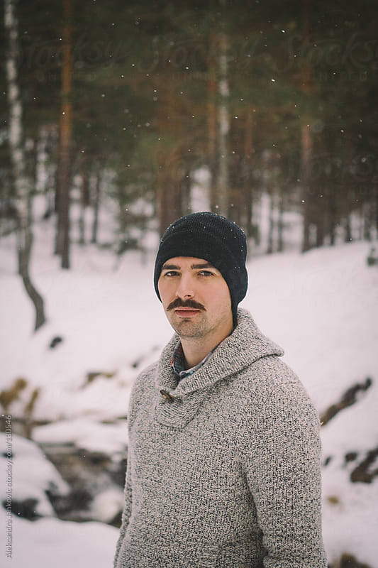 Portrait of a young man with mustache in the nature by Aleksandra Jankovic for Stocksy United