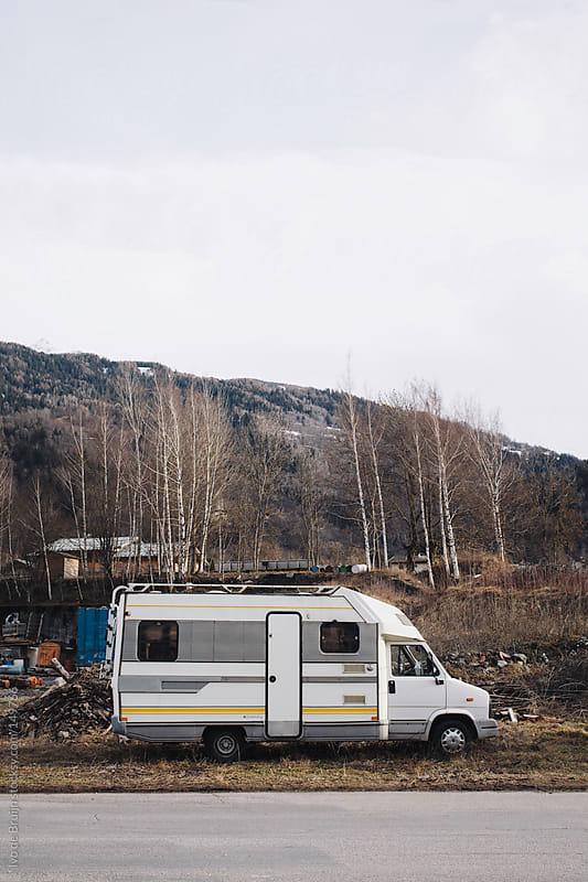 Old campervan on a dump by Ivo de Bruijn for Stocksy United