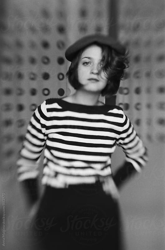 A black and white film photo of a young woman   by Anna Malgina for Stocksy United