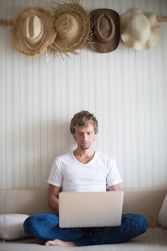 Work time - man working from home by Nabi Tang for Stocksy United