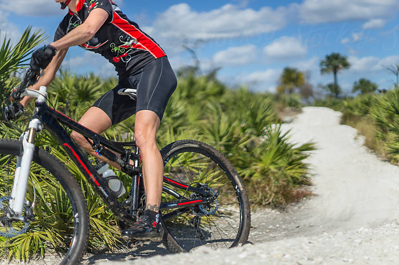 Woman Mountain Biker Hits the Trails in South Florida by suzanne clements for Stocksy United