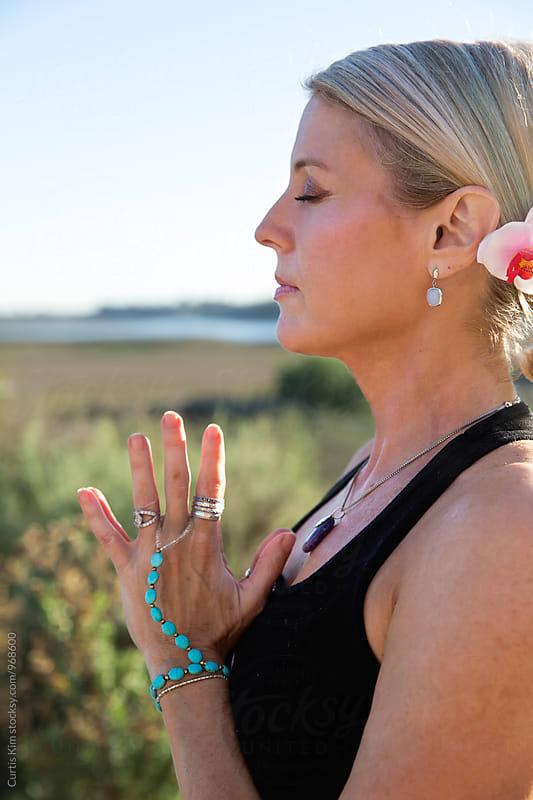 Beautiful yoga instructor in prayer pose