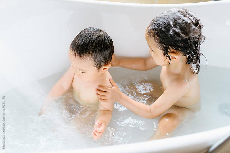 kids bathing by maahoo studio bathtub kid stocksy united. Black Bedroom Furniture Sets. Home Design Ideas