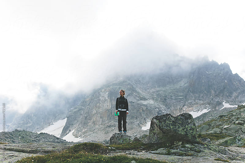 Woman standing on mountain landscape. France. by BONNINSTUDIO for Stocksy United