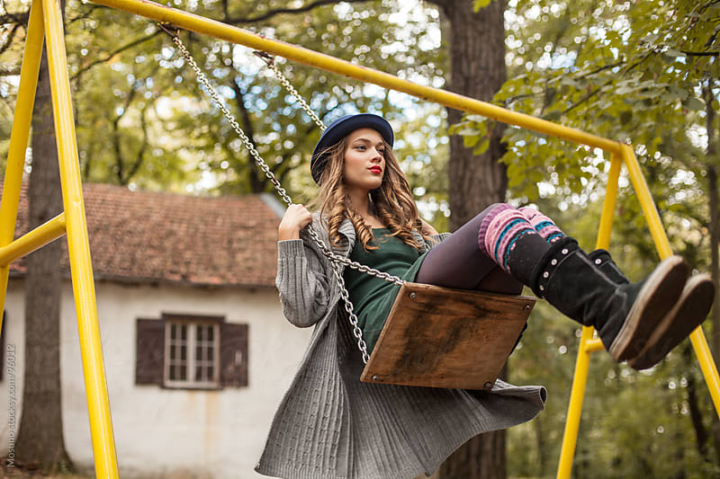 Young Woman on a Swing by Mosuno for Stocksy United
