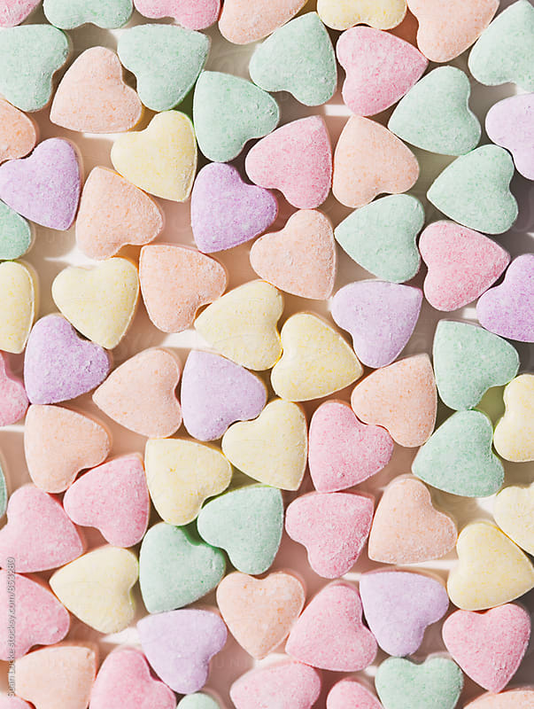 Valentine: Candy Hearts Crowded Together by Sean Locke for Stocksy United