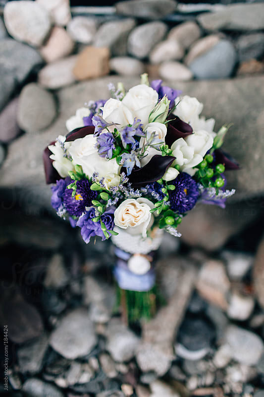Bouquet of flowers among rocks by Jakob for Stocksy United