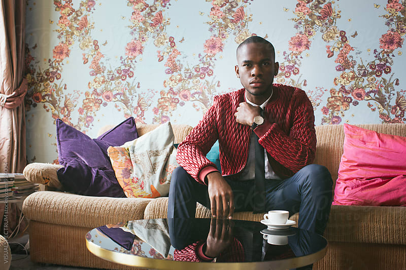 Indoor Portrait of Stylish Young Black Man in Bright Living Room by Julien L. Balmer for Stocksy United