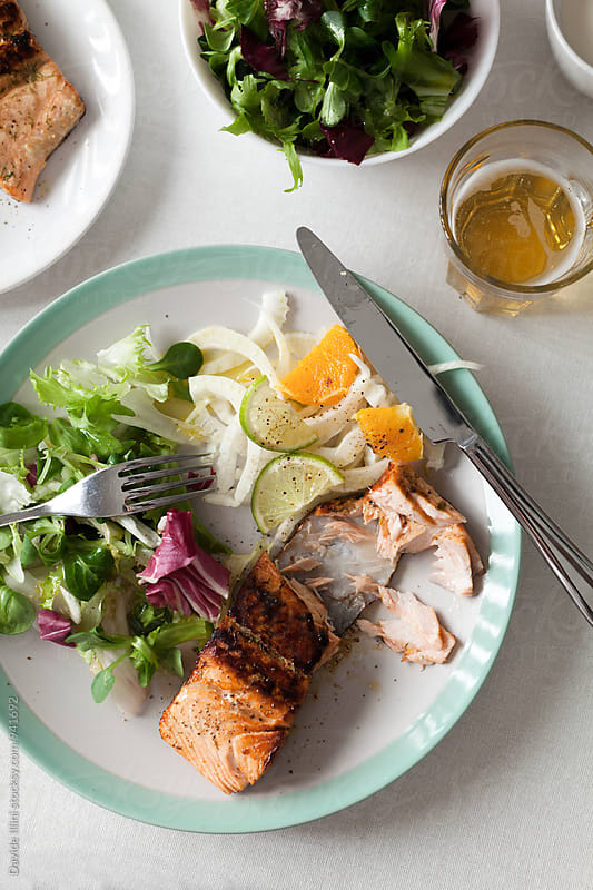 Salmon fillet with  mixed salad by Davide Illini for Stocksy United