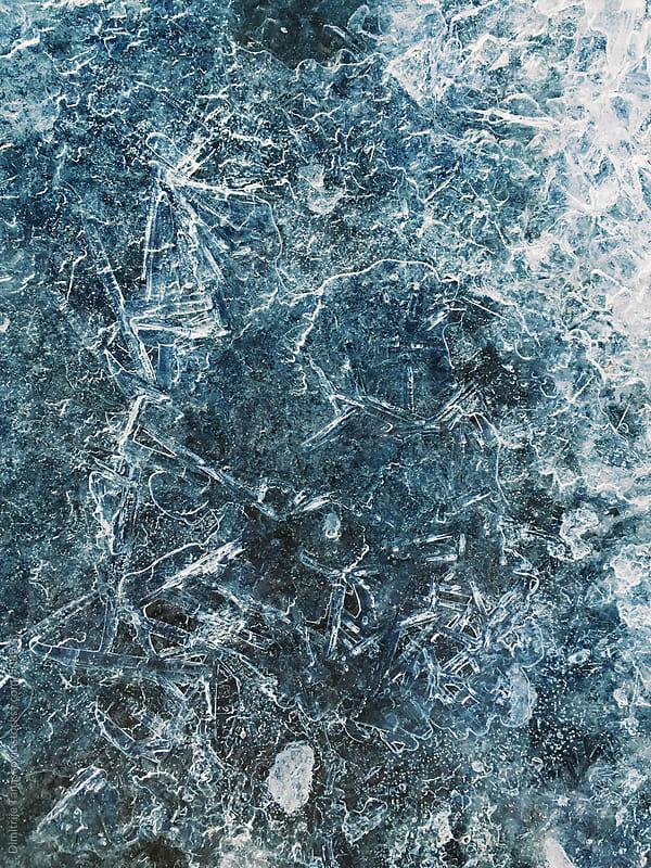 Frozen water surface background by Dimitrije Tanaskovic for Stocksy United