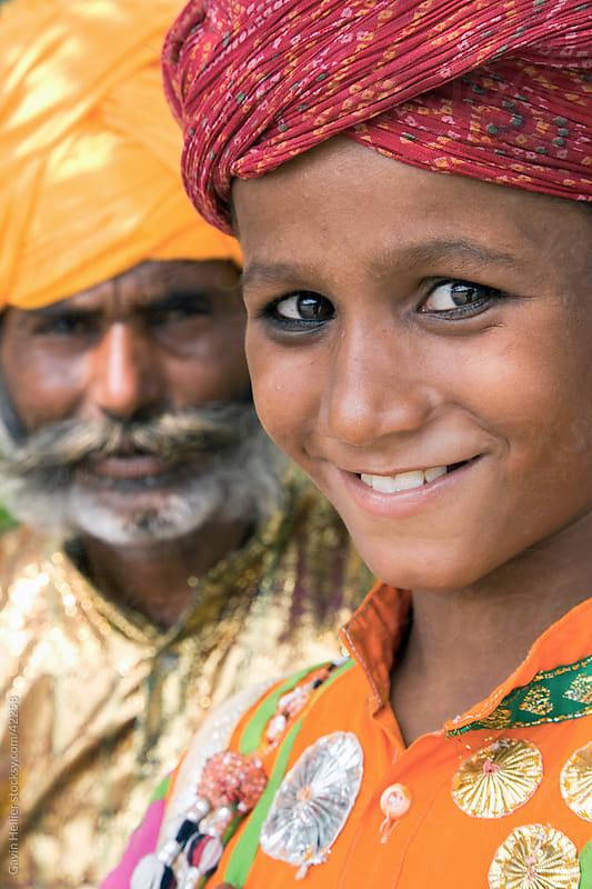 India, Rajasthan, Jaipur, portrait of a local boy and his father wearing colourful turbans by Gavin Hellier for Stocksy United
