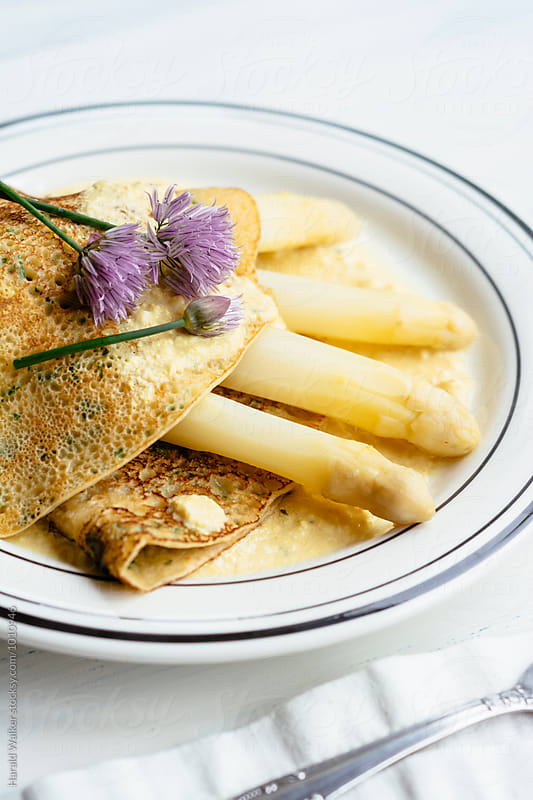 Herbed Crepes with Asparagus and Vegan Hollandaise Sauce by Harald Walker for Stocksy United