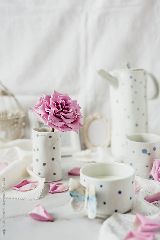 Artistic porcelain mugs with milk by Tatjana Ristanic for Stocksy United