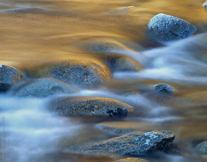 time exposure (4-sec) of autumn colors reflected in rapids on the swift river new hampshire by Ron Mellott for Stocksy United