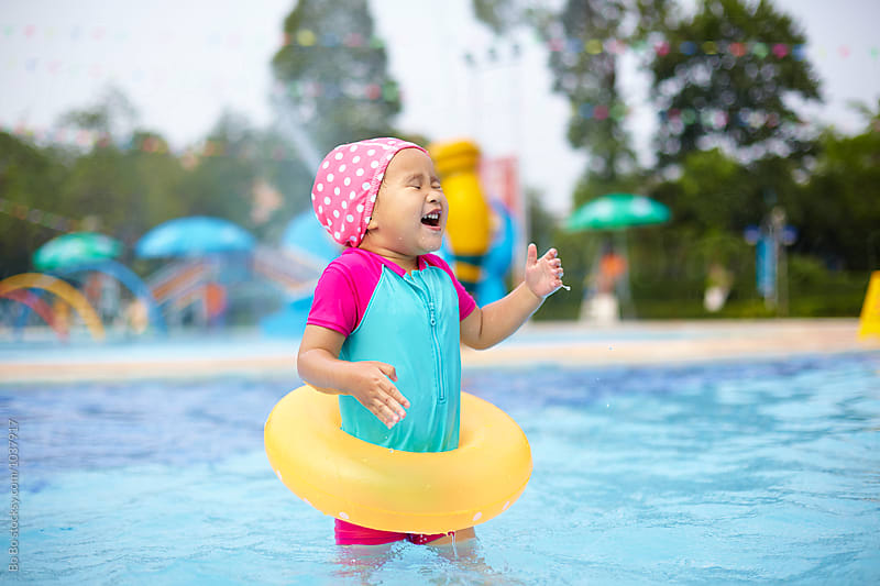 lovely little asian girl having fun in the swimming pool by cuiyan Liu for Stocksy United
