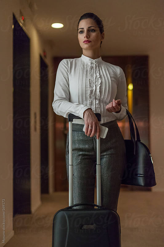 Businesswoman Standing in a Hotel Hallway by Mosuno for Stocksy United