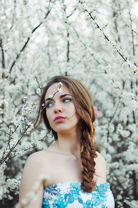 Portrait of a young woman with braid by Jovana Rikalo for Stocksy United