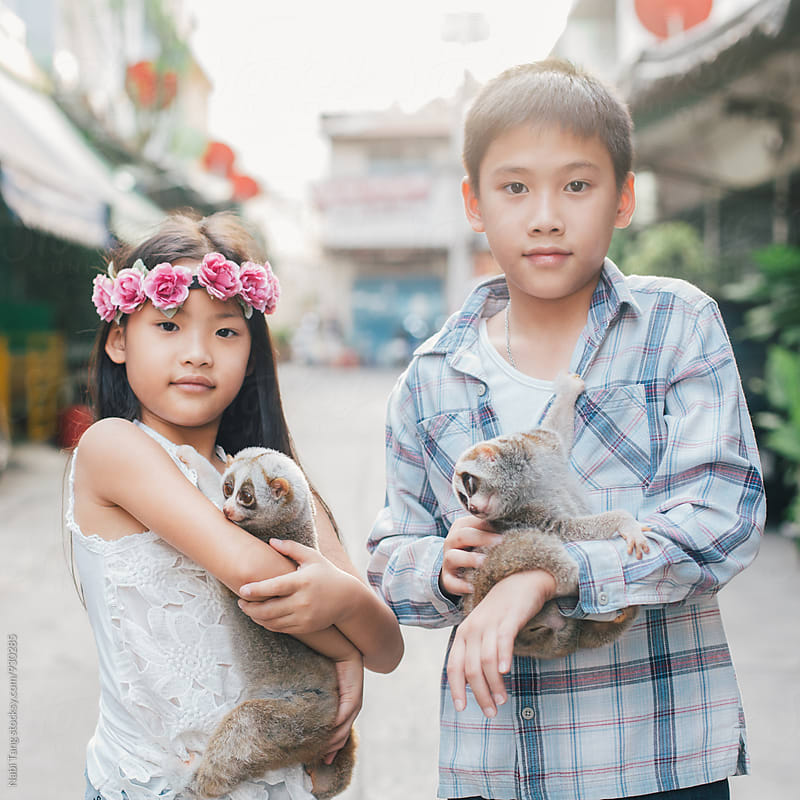 Asian kids and their pet by Nabi Tang for Stocksy United