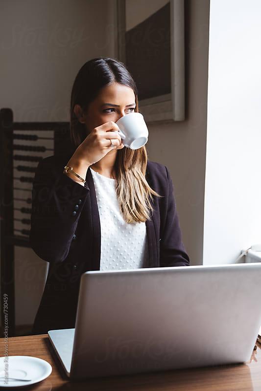 Beautiful Businesswoman Drinking Coffee by Katarina Radovic for Stocksy United