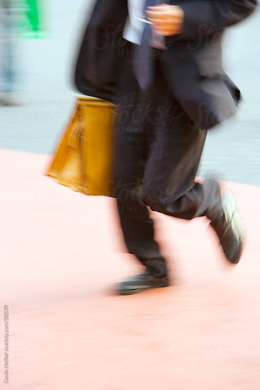 Asia, Japan, Honshu, Tokyo, Shibuya, Businessman running to work in the morning rush hour by Gavin Hellier for Stocksy United