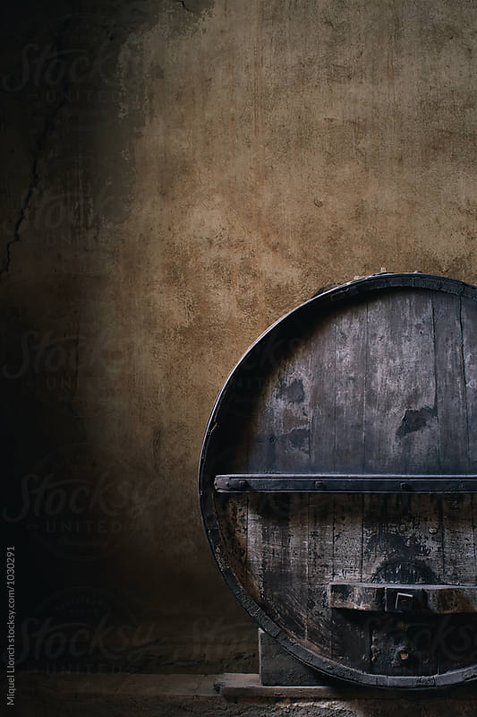 Old wine barrel and beautiful cellar wall by Miquel Llonch for Stocksy United