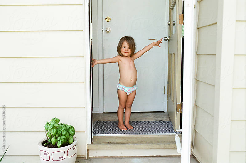 little girl stand in doorway in underwear by Maria Manco for Stocksy United