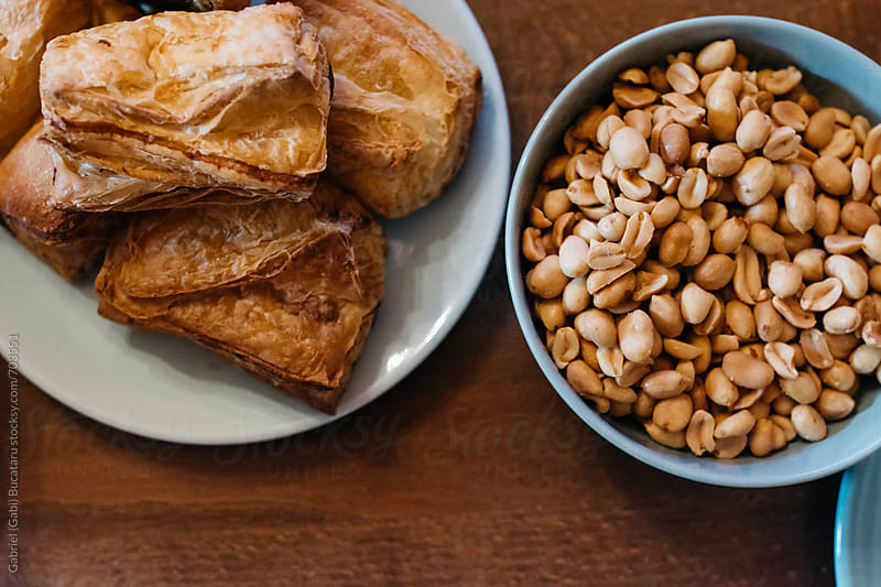 Pastry and peanuts from above by Gabriel (Gabi) Bucataru for Stocksy United