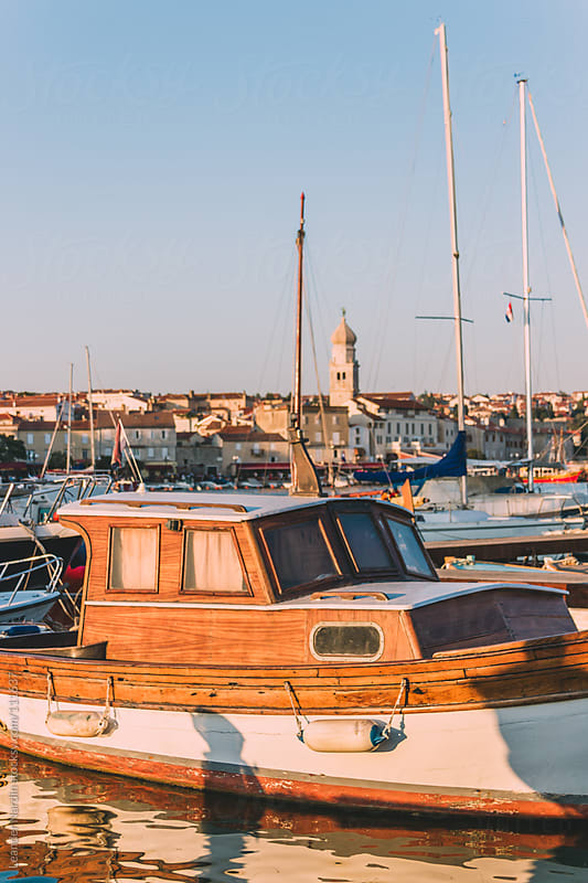 boat in the harbour of krk by Leander Nardin for Stocksy United