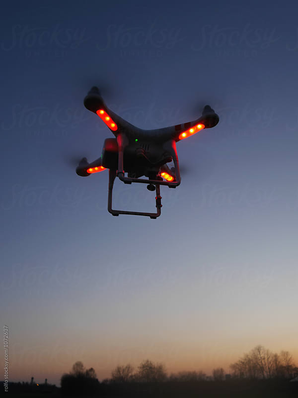 Drone with red lights against of blue sky by rolfo for Stocksy United
